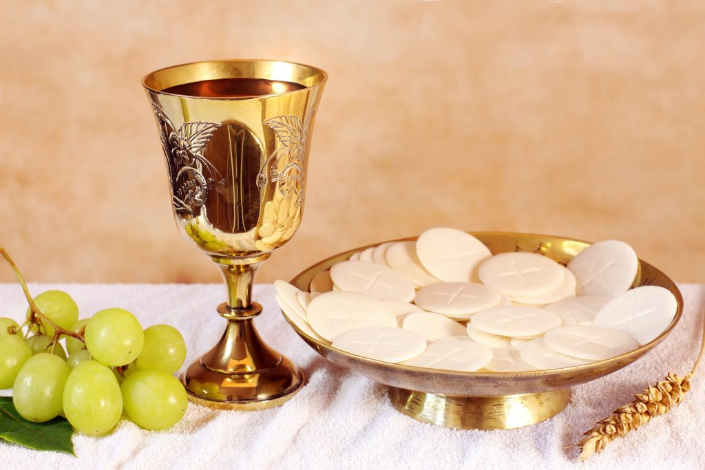 http://Chalice%20of%20wine%20and%20a%20platter%20with%20the%20Communion
