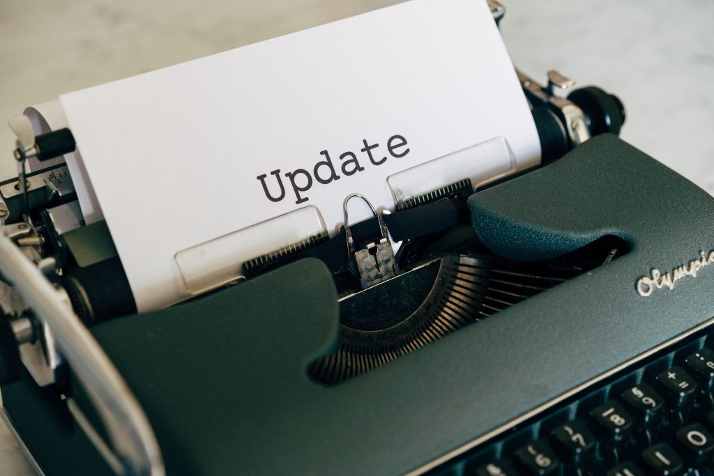 http://Typewriter%20with%20Update%20coming%20out%20of%20it.