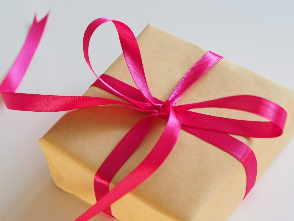 http://Present%20wrapped%20with%20paper%20and%20pink%20bow